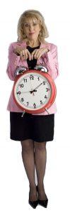 Carol Ann Small with big clock