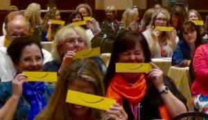 women in dental symposium smile bookmarks